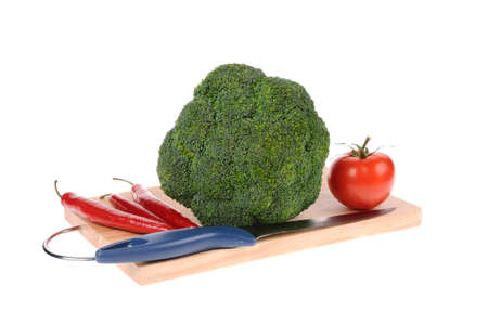 tomatto: broccoli tomatto pepper and knife on the cutting board Stock Photo