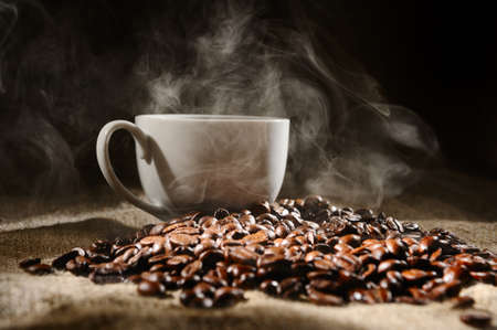 coffee beans with mug on a rough sacking  Stock Photo