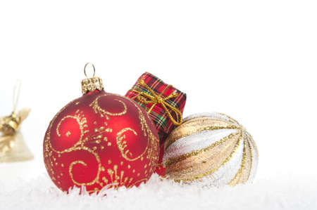 Red christmas ball with snow on white background  photo