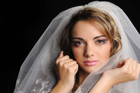 women face stare: Beauty young bride dressed in elegance white wedding dress