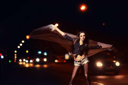 beautiful girl in fashion style. night city background Stock Photo - 13731344