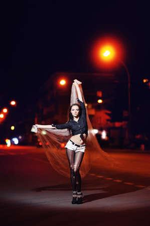 beautiful girl in fashion style. night city background Stock Photo - 13731352