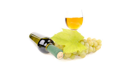 bottle of wine with glass and green grapes Stock Photo