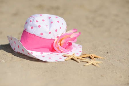 starfish with hat on sand photo