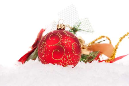 Red christmas ball with snow on white background