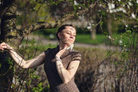 apri: attractive girl in the blossom spring garden