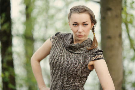 apri: attractive girl in the green  spring forest