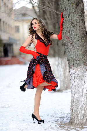 apri: attractive girl in red hat outdoor on the snow