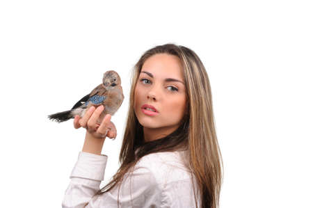 Portrait of beautiful girl with bird on the hand photo