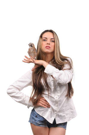 Portrait of beautiful girl with bird on the hand