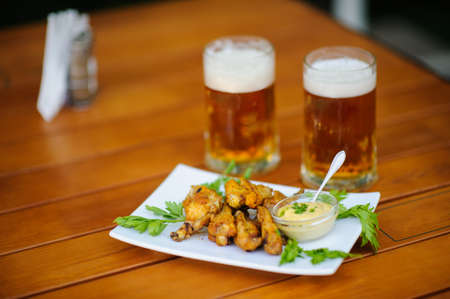 beer with meal on the table Stock Photo