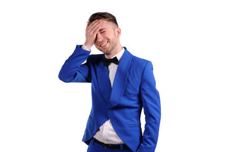 laughing man in blue suite with on white background  photo