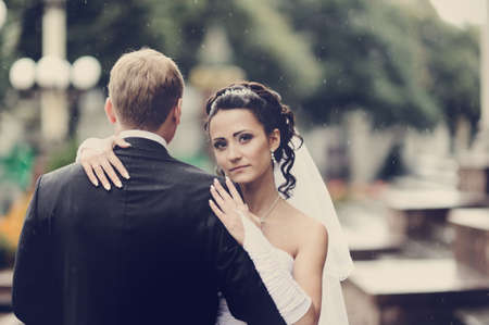 Bride and groom having a romantic moment on their wedding photo