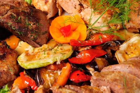 roast with baked vegetables - zucchini, pepper and dill photo