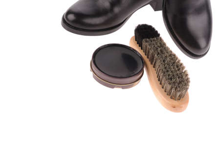 black boots with shoe brush isolated over white background photo