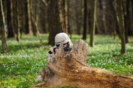 army girl: army girl with gun  outdoor in the forest Stock Photo
