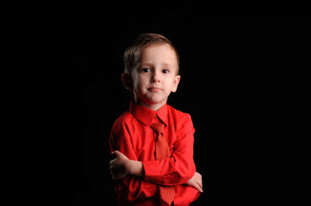 emotionally: Portrait of emotionally kid. Emotional boy on the black background Stock Photo
