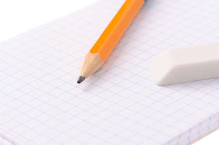 Notepad with pencil and eraser isolated over white background photo