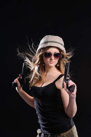 army girl: Beautiful army girl with gun isolated over black background Stock Photo