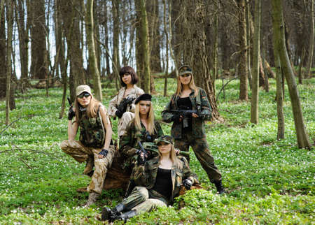 girl in the forest: Beautiful army girl with gun  outdoor in the forest