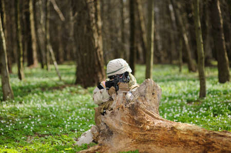 army uniform: army girl with gun  outdoor in the forest Stock Photo