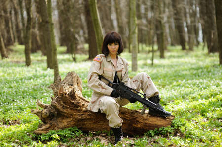 jungle girl: Beautiful army girl with gun  outdoor in the forest