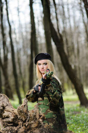 army girl: Beautiful army girl with gun  outdoor in the forest