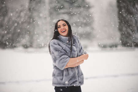 winter portrait of Beauty girl with snow - with film effect with small grain