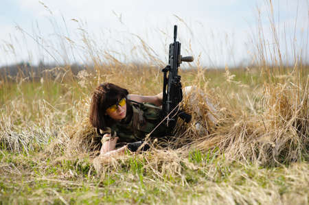 army girl: Beautiful army girl with gun  outdoor Stock Photo