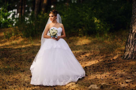 beautiful bride: Beautiful bride with bouquet of flowers outdoor
