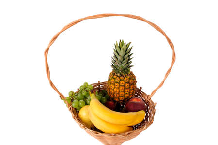 Composition with assorted fruits in wicker basket isolated on white photo