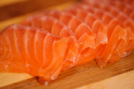 Raw and fresh salmon meat on the wooden table