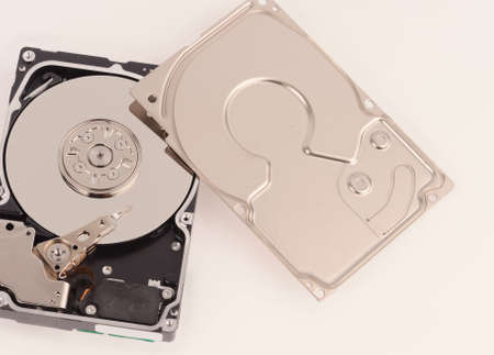 hard disk drive: opened  hard disk drive on grey background