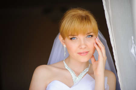 Beautiful bride  indoor near the window