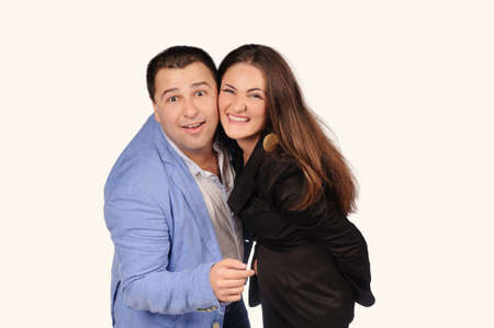 the showman: Man and woman with funny faces isolated over white background