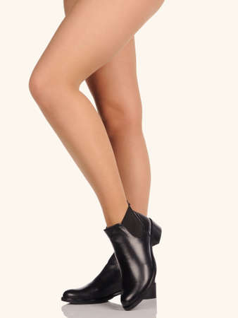 ankles sexy: Sexy female legs in black boots isolated over white Stock Photo