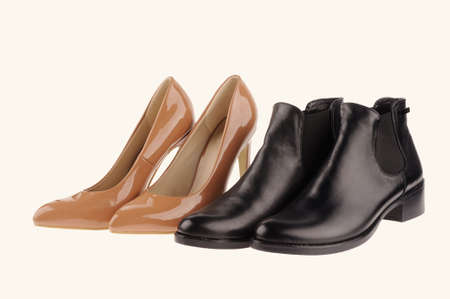 beige summer women shoes and black woman autumn shoes  isolated over white background