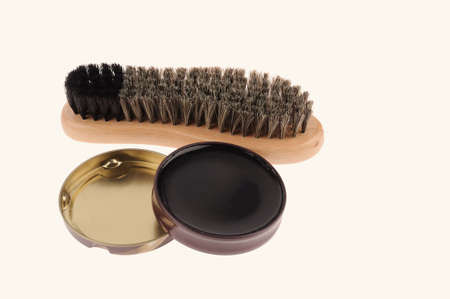 Shoe brush with wax isolated over white  background