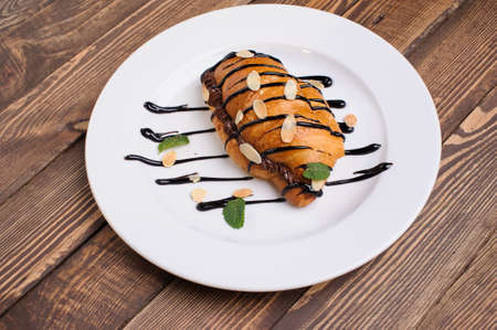 sweet croissant on the wooden table Stock Photo