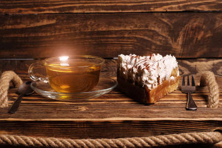 cake with tea on wooden desk