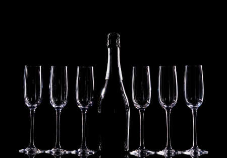 Champagne glasses set on black background
