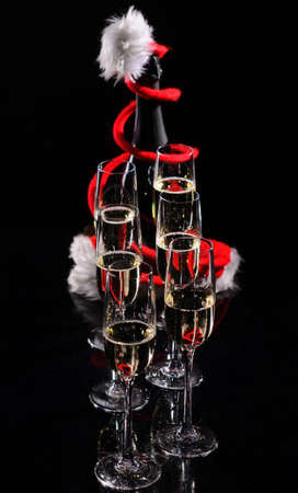 Champagne glasses set on black background with snow Stock Photo