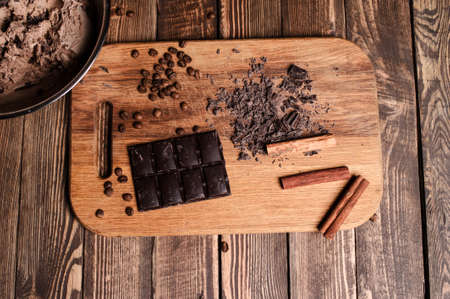 Different types of chocolate. On a wooden background.