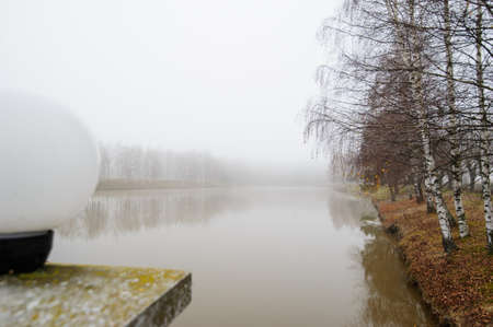 foggy morning on a small fishing pond Banco de Imagens