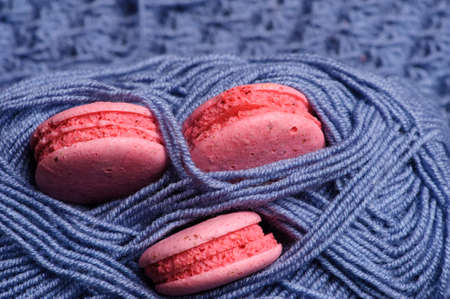 Sweet and colourful french macaroons or macaron on knitting Stok Fotoğraf