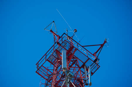 Telecommunication radio signal tower over the blue sky