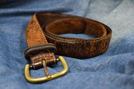 leather belt close-up put on Blue jeans