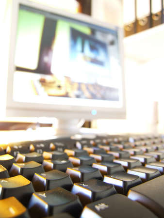 plainness: Keyboard and screen on a desktop Stock Photo