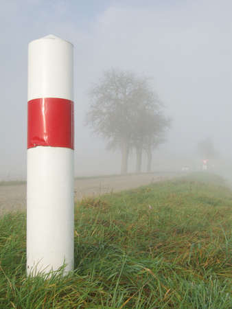 Road sign and misty weather. photo