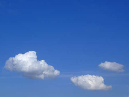 Clear blue sky with three clouds Stock Photo